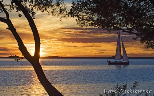 Yacht on Lake Malaren at sunset, Sundbyholm Manor, Sweden