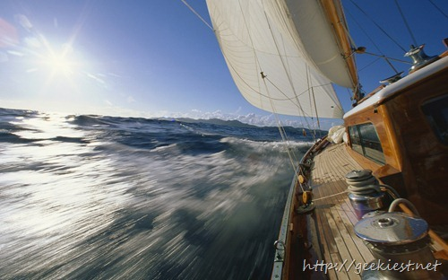 A racing yacht leans to port during Antigua Race Week, Antigua and Barbuda