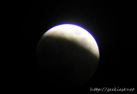 The longest and darkest total lunar eclipse of the century