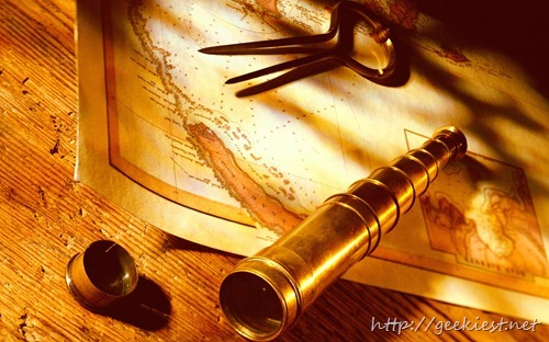 Brass telescope and navigational dividers on antique map