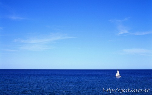 Lone sailboat in the empty ocean, Iles de la Madeleine, Quebec, Canada