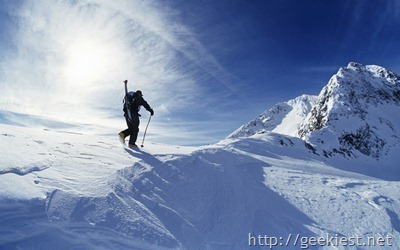 Skier hiking to summit