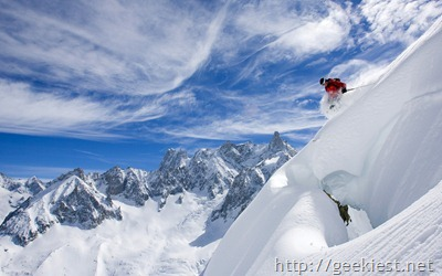 Skier descending mountain, near Chamonix-Mont-Blanc, France