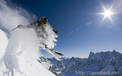 Skier in a puff of snow, near Chamonix-Mont-Blanc, France
